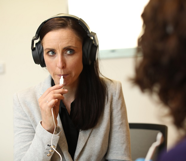 tinnitus patient in consultation with healthcare professional